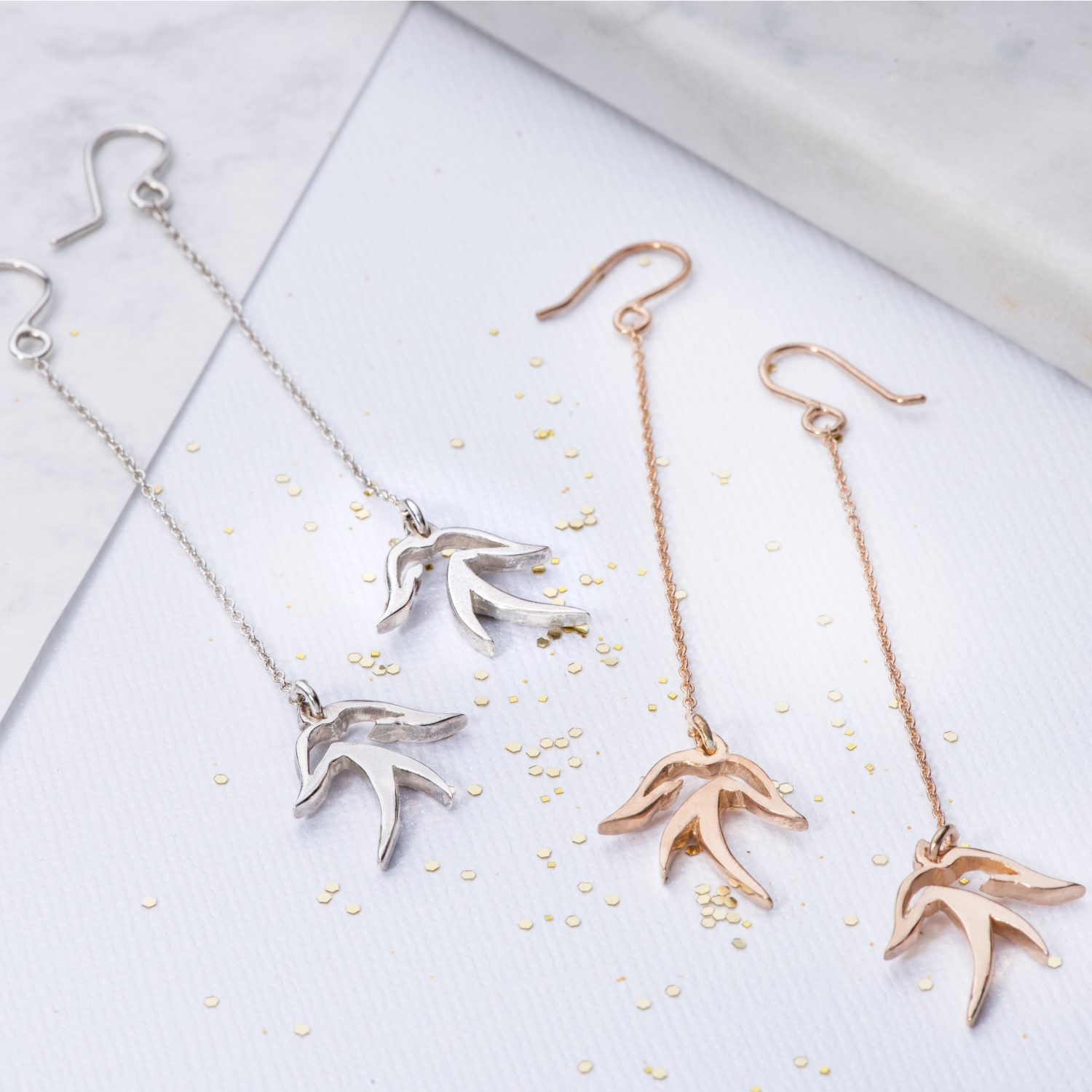 Drop bird earrings in silver and rose gold