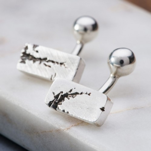 Heavy rectangle silver cufflinks with rip detail