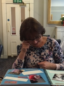 Mum reading her Scrap book of memories over the years a few tears shed #makeagiftday