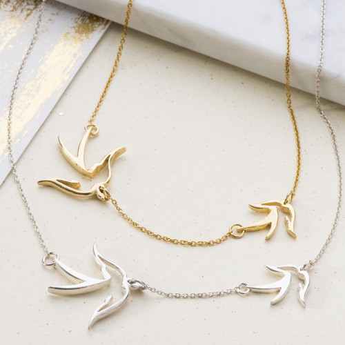 Double bird necklace symbolising mother and child