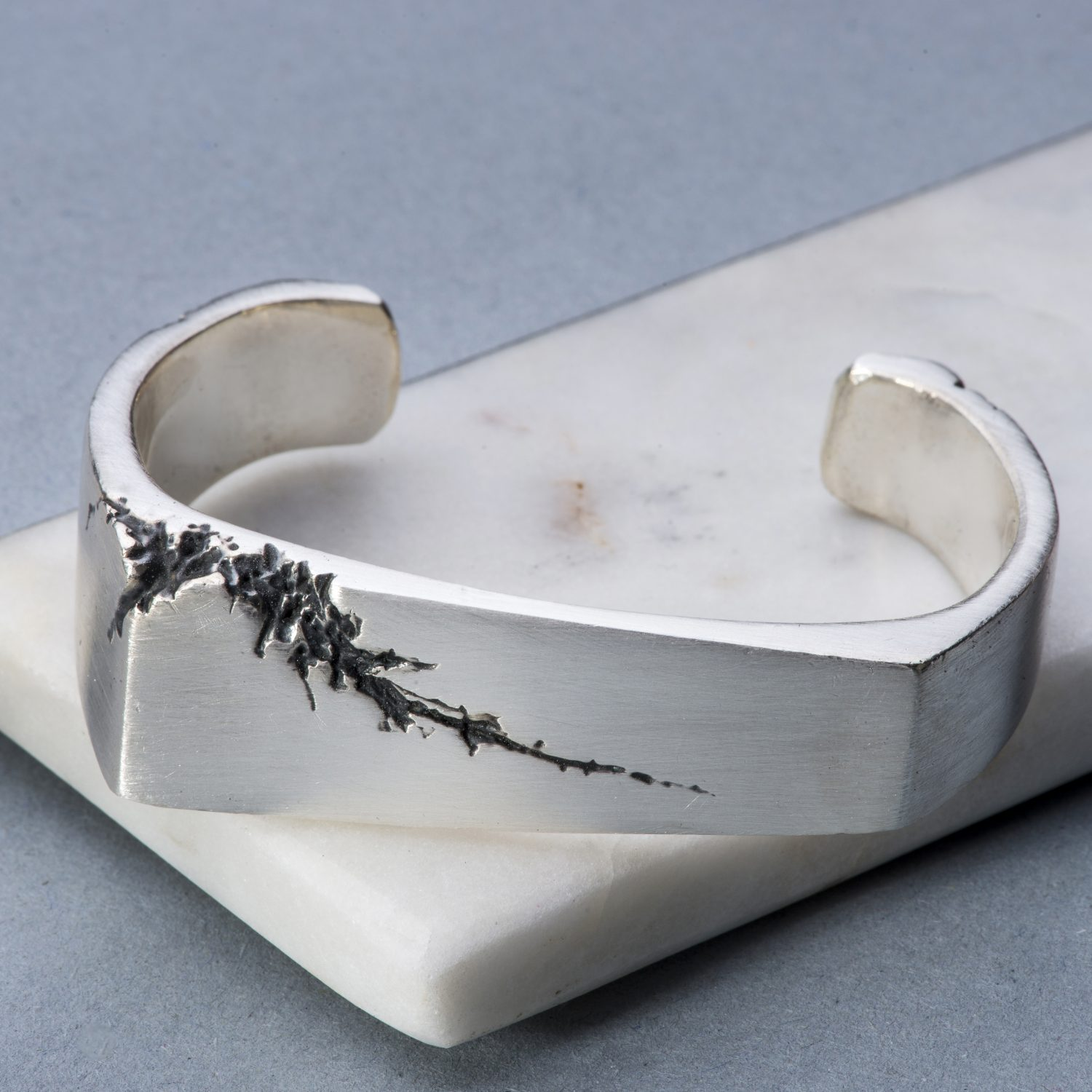 Angular solid silver mens cuff with crack detail