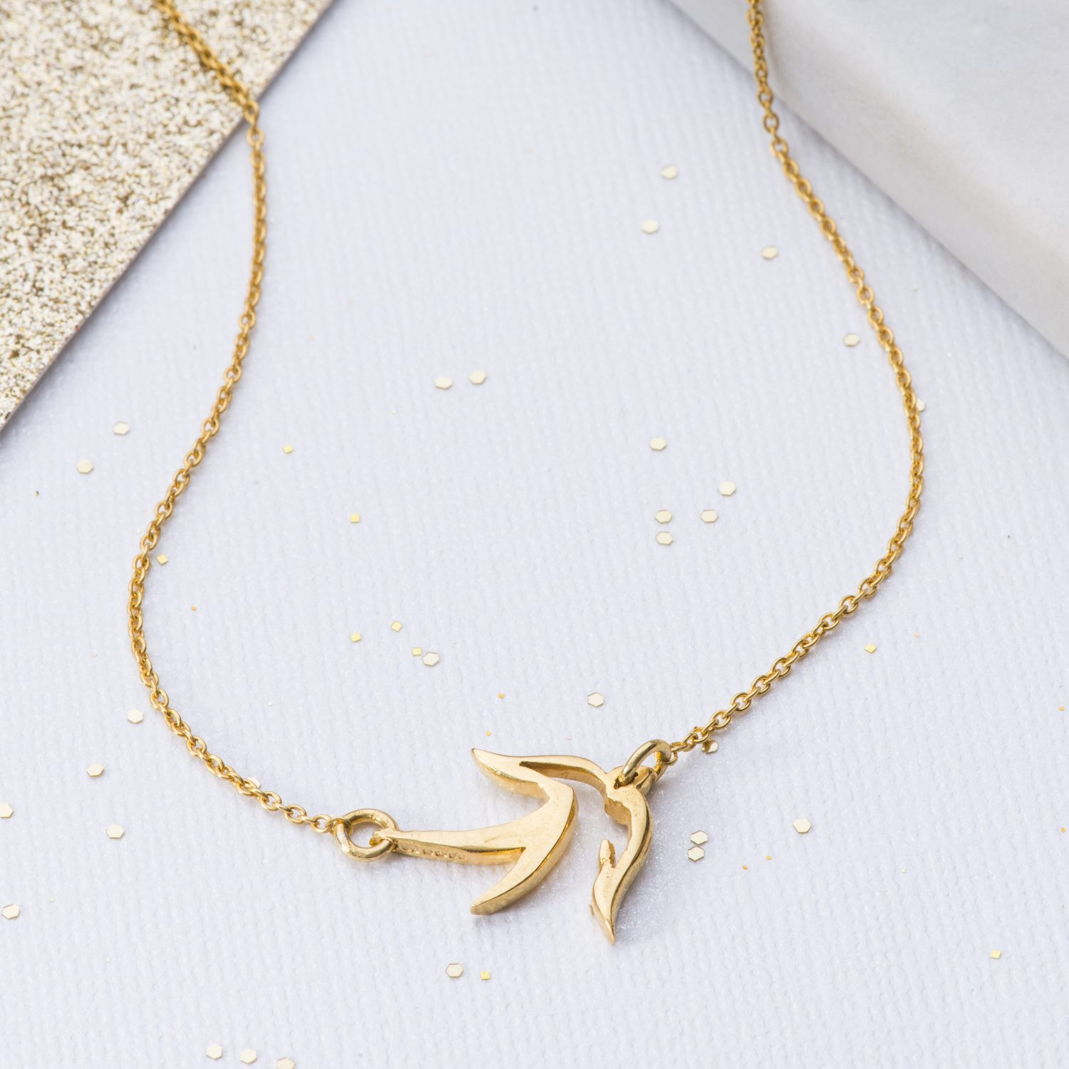 Yellow Gold little bird pendant