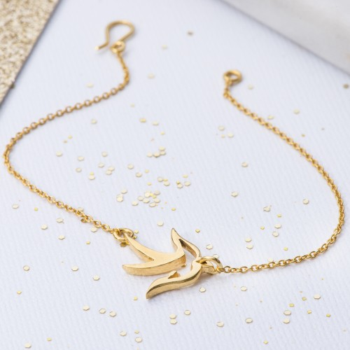 Yellow gold small bird bracelet