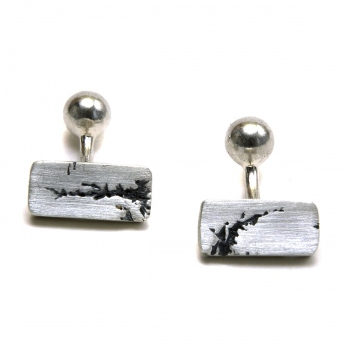 Rectangle silver cufflinks with blackened rip detail