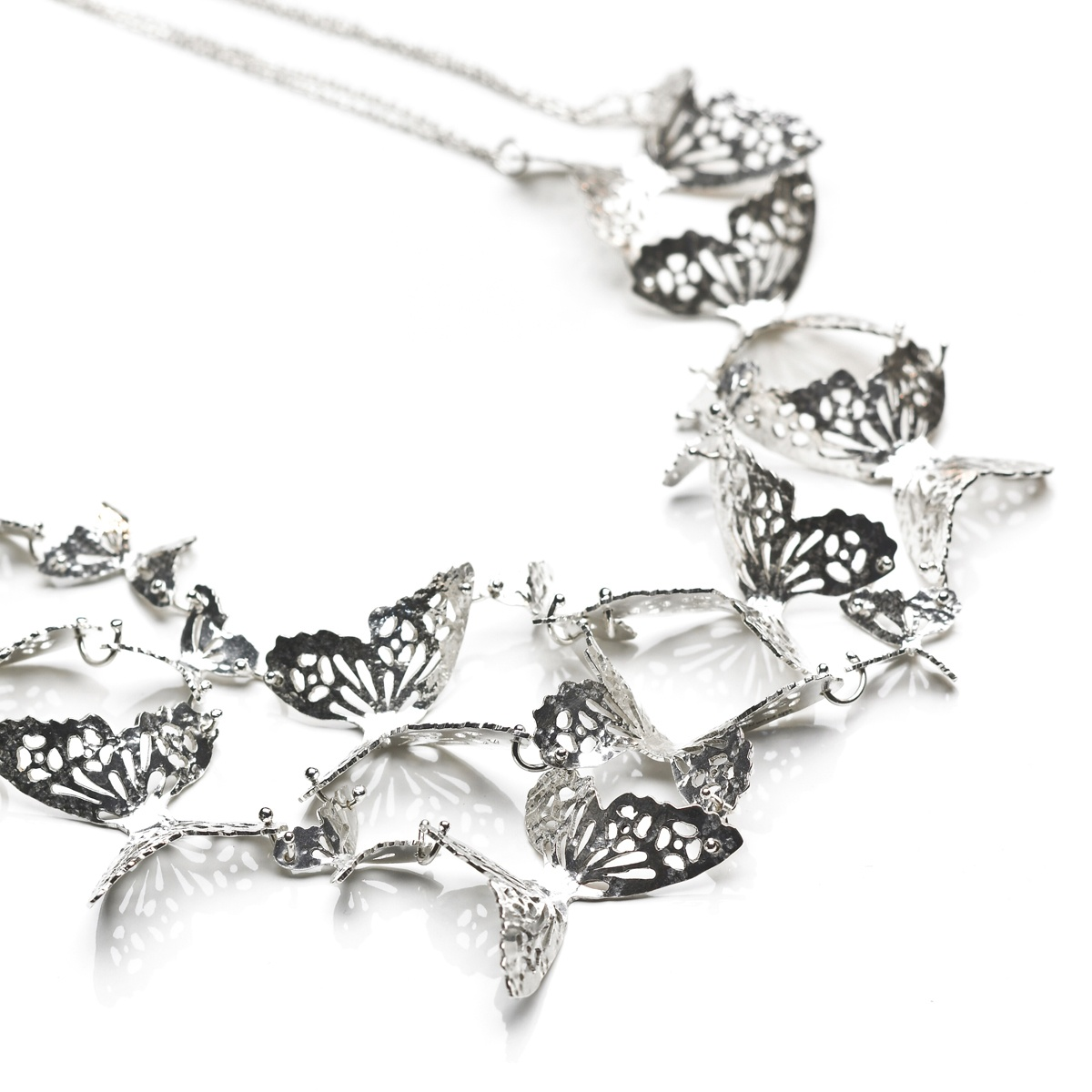 Delicate yet striking this Large Multi Butterfly necklace features handmade textured butterflies linked together to make the most stunning statement necklace