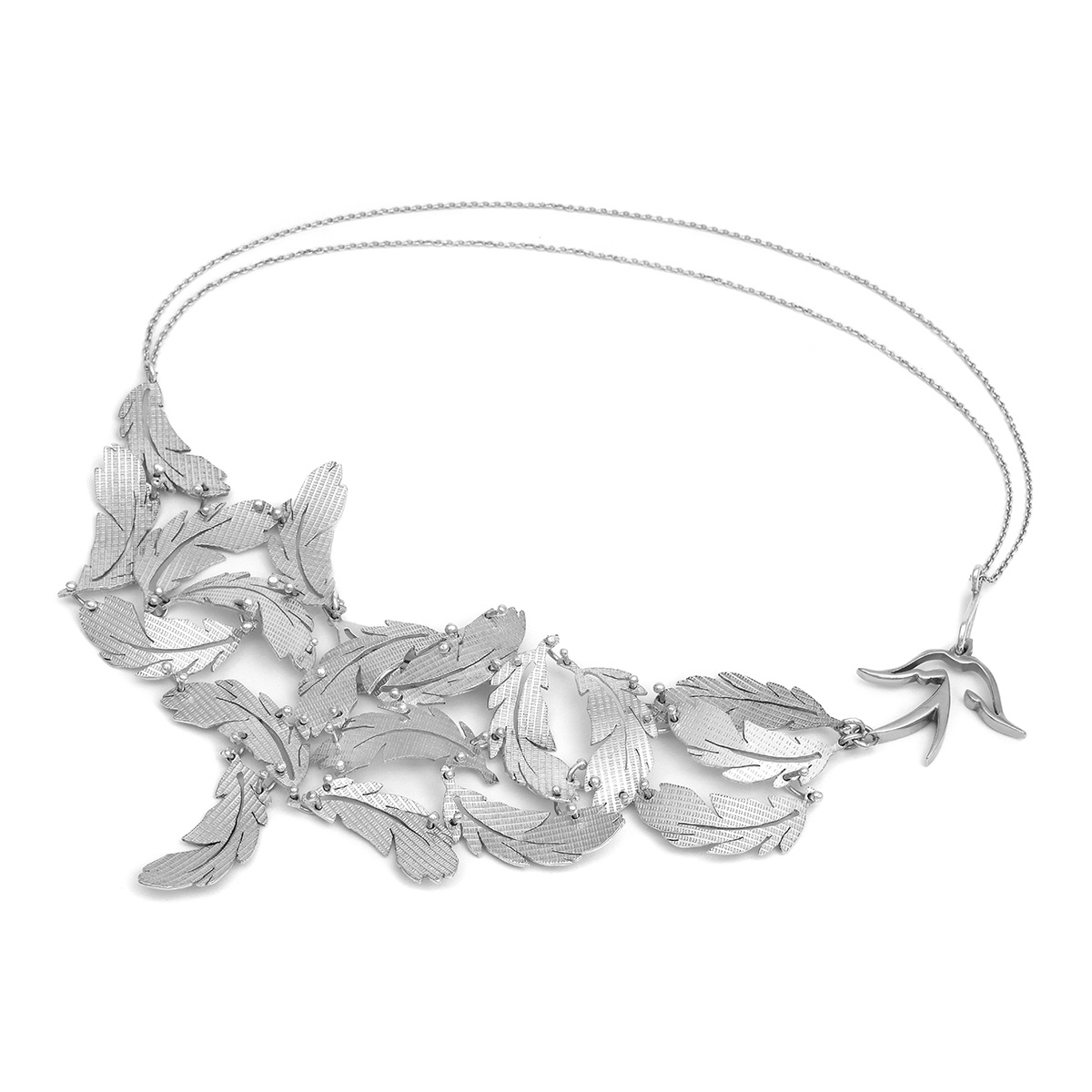 This stunning statement feather necklace is made up of handmade textured feathers, curved and joined so they move subtly and fit comforably.